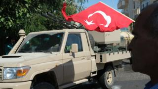 Turkish military vehicle and flag