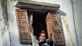 People look out of a window in Rabat, Morocco - Friday 27 March 2020