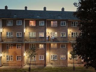 Family outside their home on an estate, Edmonton, London
