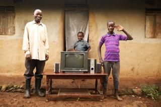 Musingo, 60, with two of his grandsons