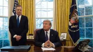 President Donald Trump with US Sales Representative Robert Lighthizer at the White House Oval Office in Washington, DC, January 23, 2018.