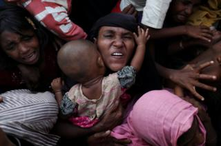 Rohingya Muslims scuffle as they wait to receive relief aid at Kutupalong refugee camp, near Cox's Bazar, Bangladesh.