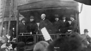 Woodrow Wilson, seen here on the back of a train, revived the practice of the spoken address