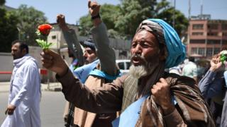 An Afghan peace activist shouts slogans in demand to an end to the war during a march from Helmand as he arrives in Kabul on June 18, 2018