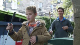 Ethan Loch and Daniel Kish at a school