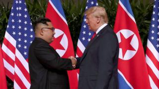 US President Donald Trump and North Korean leader Kim Jong-un shake hands during the Singapore Summit in 2018