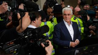 Photographers surround British publicist Max Clifford as he leaves Westminster Magistrates Court in 2013 where he entered not guilty pleas after being charged with 11 counts of indecent assault