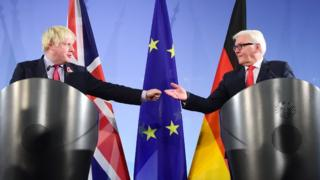 Boris Johnson offers Frank-Walter Steinmeier a fist bump during a joint news conference in Berlin on 4 November.