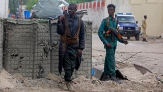 Two soldiers at the scene of the blast in Mogadishu