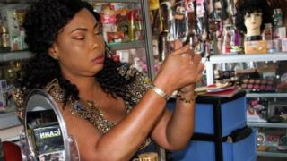 Shopkeeper Ruth Dossouvi dey rub bleaching cream for her shop in Lome, Togo for June 29, 2018.