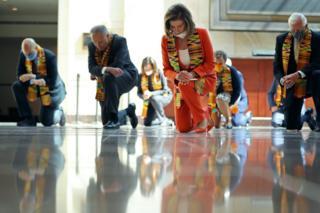 in_pictures US Democrats kneel on a reflective floor