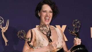 Phoebe Waller-Bridge holding her Emmys