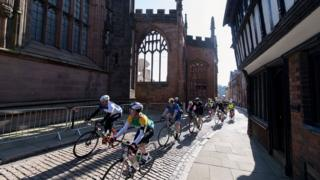 Riders passing Coventry Cathedral