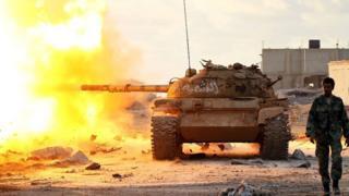 Tank fired as soldier walks ahead in Benghazi