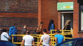 People queue at job centre