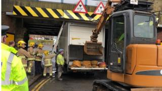 Lorry being moved after getting stuck under a bridge in Lisburn