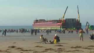 barge at Black Rock beach