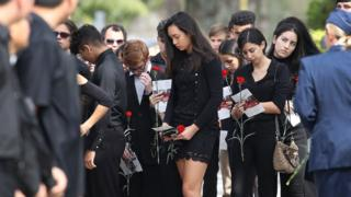 Mourners attend the funeral of Peter Wang, 15, on 20 February 2018 in Coral Springs, Florida