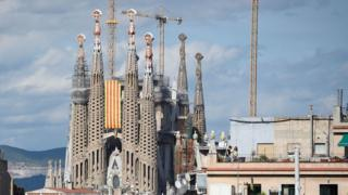 Barcelona's Sagrada Familia cathedral decorated with a Catalan banner for the national day of Catalonia