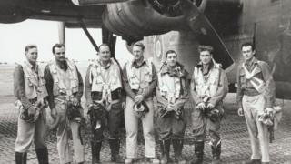 Jim Auton (second left) with aircrew in front of a B-24