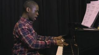 Michael Fuller performing at the piano