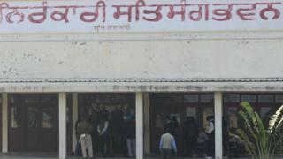 NIA) officials inspect the scene at Nirankari Satsang Bhawan in Rajasansi village on the outskirts of Amritsar on November 19, 2018
