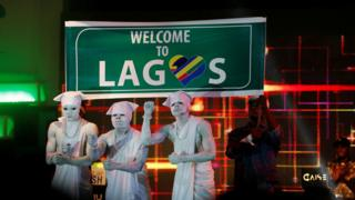 Clowns perform on stage at the One Lagos fiesta in Nigeria's commercial capital Lagos