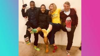 Doctor Who cast in their colourful socks.