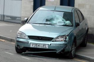 The Ford Mondeo involved in the crash, showing damage to the windscreen and passenger side headlight