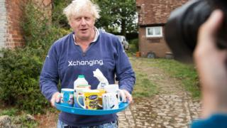 Boris Johnson outside his Oxfordshire home with a tray of tea