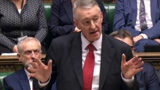 Hilary Benn with Jeremy Corbyn behind
