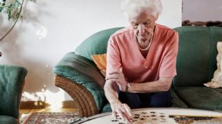 Woman doing jigsaw