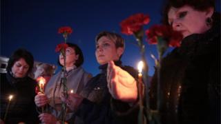 Kırım'da saldırıda hayatını kaybedenleri anmak için düzenlenen törenden bir fotoğraf
