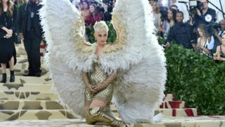 Katy Perry wears outsized angel wings in honour of this 365 days's elegant theme.