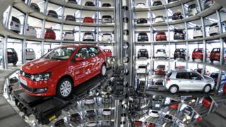 "Volkswagen Golf VI are stored at the ""CarTowers"" in the theme park Autostadt next to the Volkswagen plant in Wolfsburg, Germany, in this March 10, 2010 file photo."