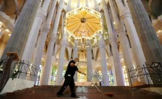 A man cleans the basilica of the Sagrada Familia before its reopening, after being closed for over three months due to the outbreak of the coronavirus, Spain, 3 July 2020