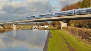 Graphic of HS2 train on bridge over river