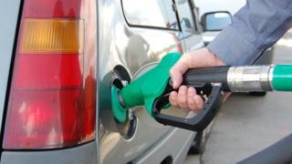 Man putting petrol into car