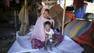 Sabikul Nahar poses for a photo with a kid at a refugee camp in Cox's Bazar, Bangladesh on December 19, 2017