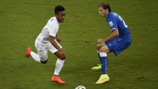 Sterling (left) at the 2014 World Cup, playing in England's match against Italy