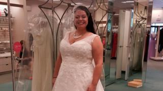 woman standing in wedding dress