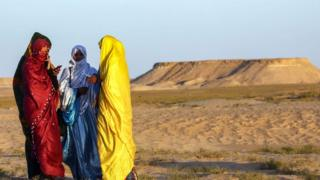 Tuareg women attend a traditional ceremony in the Libyan desert in the western Awal region near the borders with Tunisia and Algeria, about 600km (373 miles) southwest of the capital, Tripoli, on 29 March 2019