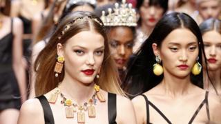 Models in a Dolce & Gabbana show in 2018