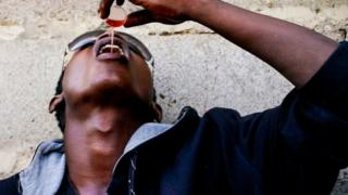 Boy pours codeine cough syrup down his throat