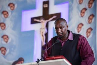 Alex Niyonzima, a survivor of the capsized cruise boat in Lake Victoria, speaks his ordeal during a funeral service of his friend who were also on the boat at Our Lady of Mount Carmel church in Kampala, Uganda -26 November 2018