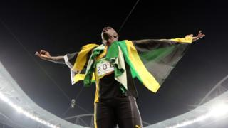 """Jamaica""""s Usain Bolt celebrates winning the gold medal in the men""""s 4x100-meter relay final during the athletics competitions of the 2016 Summer Olympics"""