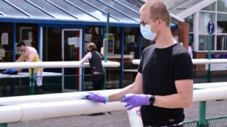Staff wiping down surfaces at Leicester Racecourse