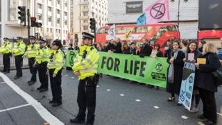 Police and protestors at London Fashion Week