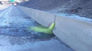 Officials closed a stretch of the highway after the liquid was seen oozing through paving
