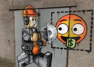 Graffiti artist Ame72 in surprise Port Talbot street art